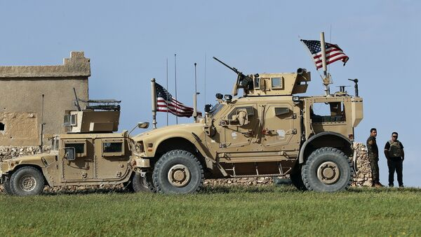 In this picture taken on Thursday, March 29, 2018, a fighter, second from right, of U.S-backed Syrian Manbij Military Council stands next to U.S. humvee at a U.S. troop's outpost on a road leading to the tense front line between Syrian Manbij Military Council fighters and Turkish-backed fighters, at Halawanji village, north of Manbij town, Syria - Sputnik International