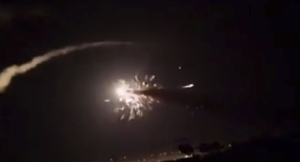This frame grab from a video provided by the Syrian Arab News Agency (SANA) shows missiles flying into the sky near Damascus, Syria, 25 December 2018.