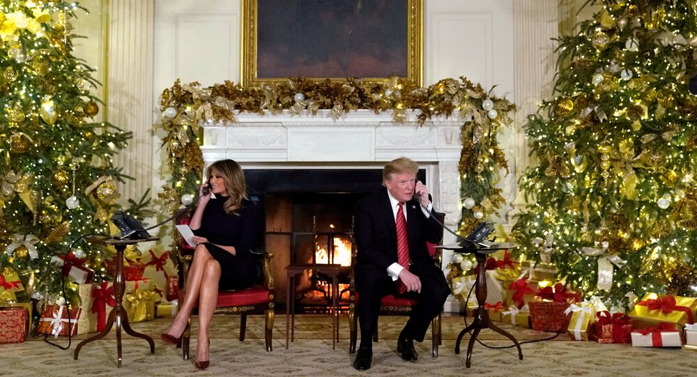 U.S. President Donald Trump and first lady Melania Trump participate in NORAD Santa tracker phone calls from the White House in Washington, U.S. December 24, 2018