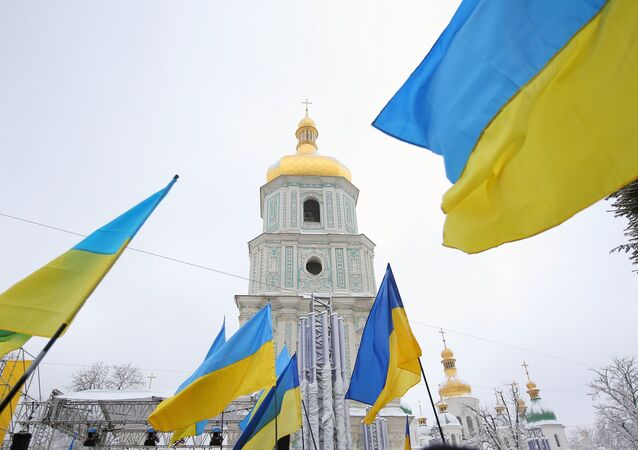 Ukrainian President Petro Poroshenko signed into law a bill obliging the canonical Ukrainian Orthodox Church of the Moscow Patriarchate (UOC-MP) to change its name.