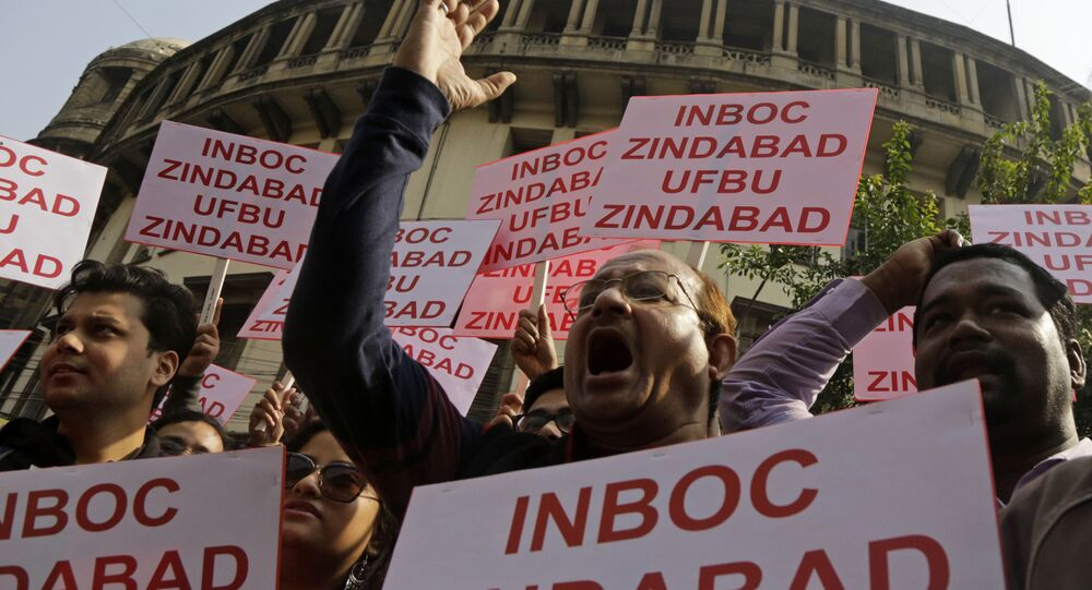 Employees of different banks shout slogan as they walk in a rally during a nation-wide bank strike in Kolkata, India, Wednesday, Dec. 26, 2018
