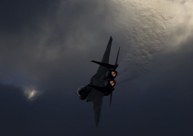 Israeli Air Force F-15 plane performs during a graduation ceremony for new pilots in the Hatzerim air force base near the city of Beersheba, Israel, Thursday, Dec. 29, 2016