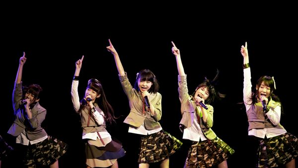 In this photo taken Saturday, Jan. 12, 2013, members of SNH48, a Shanghai-based Chinese girls group, perform during their first appearance on stage in Shanghai, China. They are a newly-launched sister group of Tokyo-based AKB48 - Sputnik International