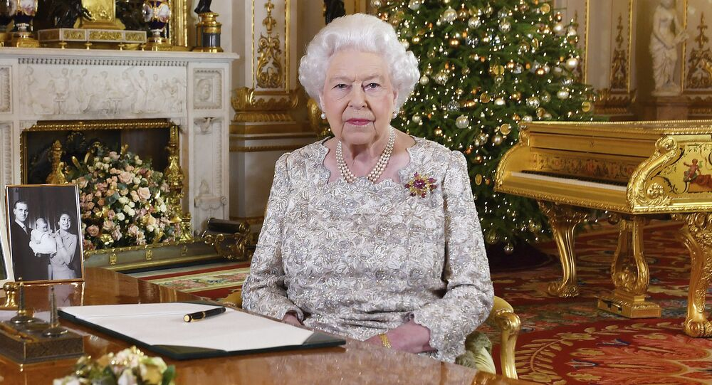 In this photo released on Monday, Dec. 24, 2018, Queen Elizabeth II poses after she recorded her annual Christmas Day message, in the White Drawing Room of Buckingham Palace in central London