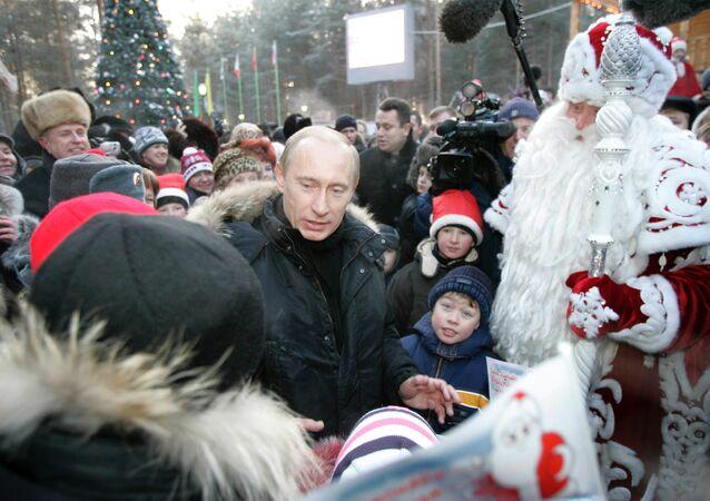 President Vladimir Putin meeting with children outside Grandfather Frost's residence in Veliky Ustyug