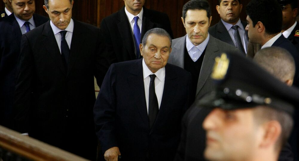 Former Egyptian President Hosni Mubarak, center, arrives with his sons Alaa, left, and Gamal, right, to testify in a courtroom at the National Police Academy in Cairo, Egypt, 26 December 2018.