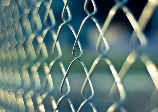 A chainlink prison outside a jail