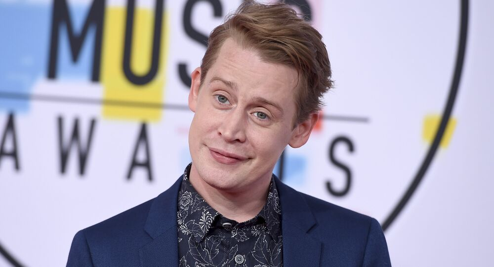 Macaulay Culkin arrives at the American Music Awards on Tuesday, Oct. 9, 2018, at the Microsoft Theater in Los Angeles