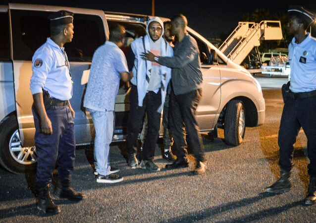 French national Peter Cherif (C) alleged associate of the Kouachi brothers, perpetrators of 2015 Charlie Hebdo attack, steps out a car as he is extradited to France at Djibouti International Airport in Djibouti on December 22, 2018