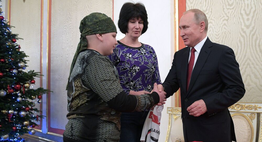A very sick 10-year-old boy from the Russian southern region of Stavropol, whose dream it has been to shake hands with Russian President Vladimir Putin, was given a tour of the Kremlin on Thursday as part of a program that helps children in similar conditions.