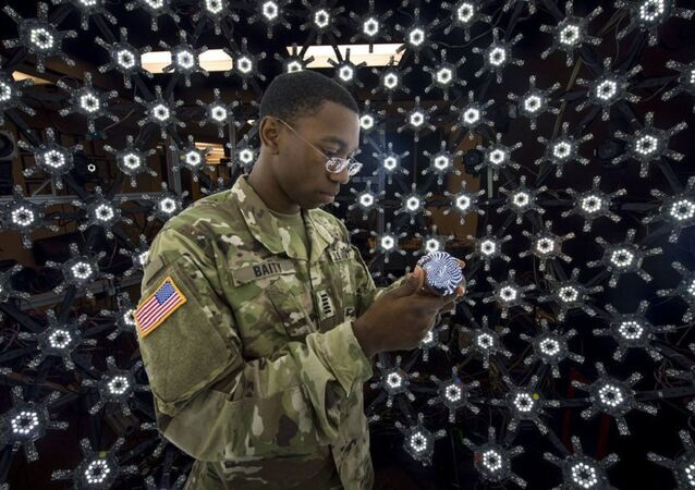 A Soldier demonstrates the Light Stage X capture system technology