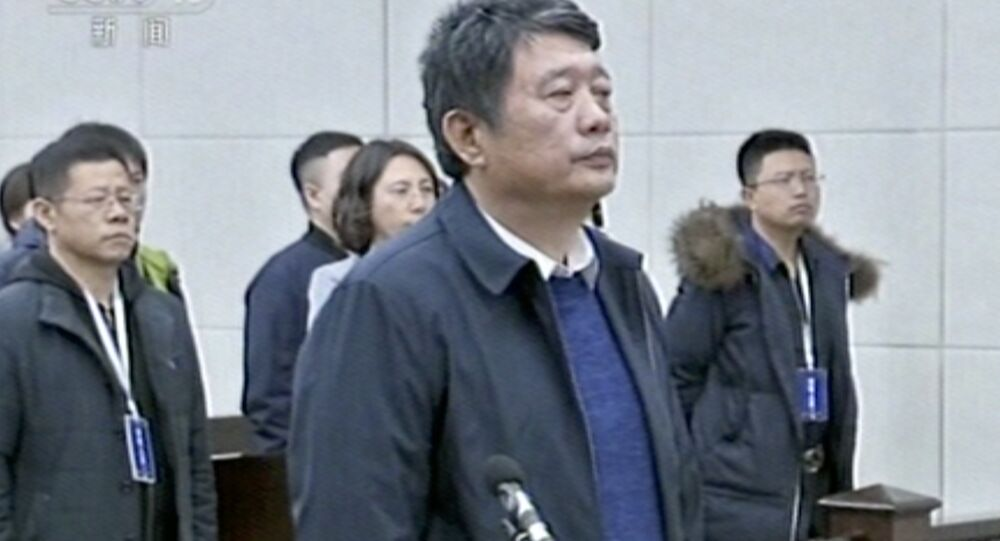 In this image made from Dec. 27, 2018, CCTV video, China's former deputy intelligence chief Ma Jian appears in a courtroom in the northeastern port city of Dalian, China. The court said Ma Jian has been found guilty of crimes including accepting bribes and insider trading. Ma, who previously was the vice minister of the state security bureau, was also ordered to pay more than 50 million yuan ($7.26 million) in penalties.