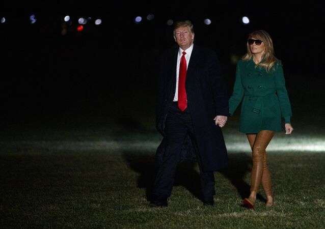 President Donald Trump and first lady Melania Trump arrive on the South Lawn of the White House after making a surprise visit to troops in Iraq