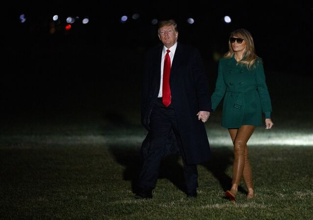 President Donald Trump and first lady Melania Trump arrive on the South Lawn of the White House after making a surprise visit to troops in Iraq, Thursday, Dec. 27, 2018, in Washington