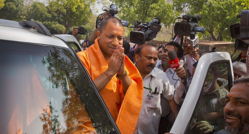 The new Chief Minister of the northern Indian state of Uttar Pradesh Yogi Adityanath greets media as he arrives at the Parliament in New Delhi, India, Tuesday, March 21, 2017