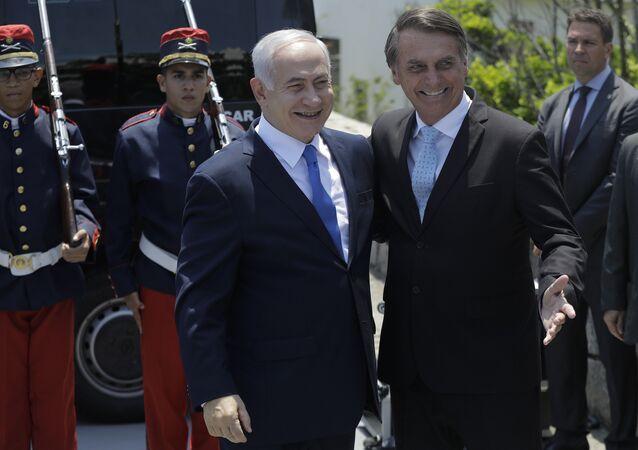 Israeli Prime Minister Benjamin Netanyahu, left center, is received by Brazil's President-elect Jair Bolsonaro at the military base Fort Copacabana, in Rio de Janeiro, Brazil, Friday, Dec. 28, 2018.