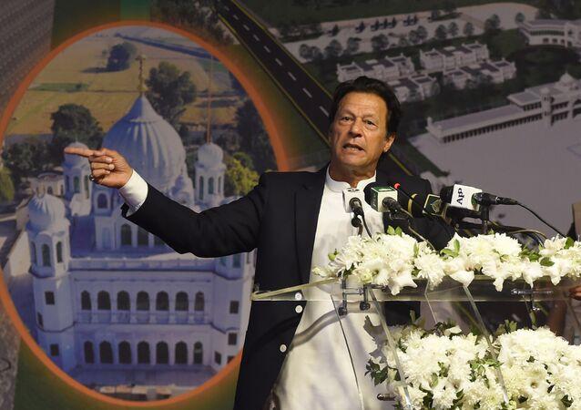 Pakistan Prime Minister Imran Khan (C) addresses the groundbreaking ceremony for the Kartarpur Corridor in Kartarpur on November 28, 2018