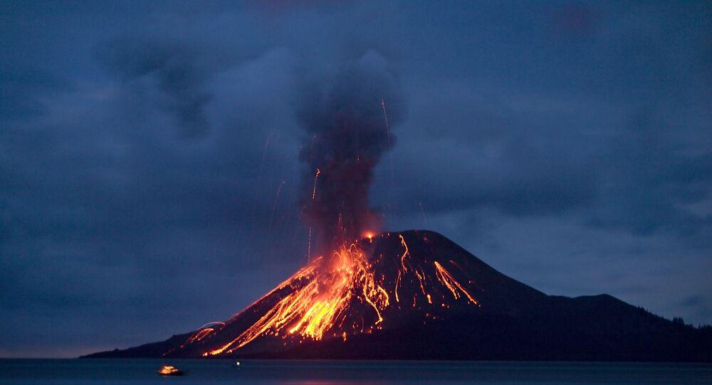 The Anak Krakatau (Child of Krakatau) volcano sends up powerful clouds of hot gasses, rocks, and lava