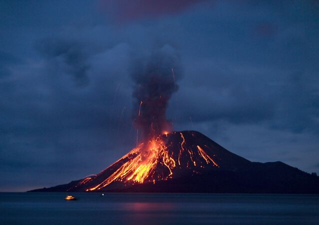 The Anak Krakatau (Child of Krakatau) volcano sends up powerful clouds of hot gasses, rocks, and lava