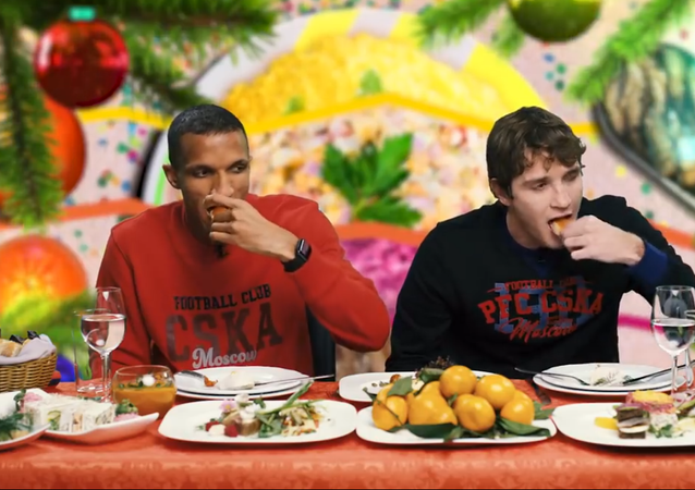 CSKA football players eating traditional Russian dishes