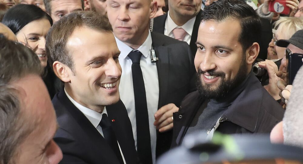 (FILES) In this file photo taken on February 24, 2018 French president Emmanuel Macron (C,L) flanked by Elysee senior security officer Alexandre Benalla (C,R) visits the 55th International Agriculture Fair (Salon de l'Agriculture) at the Porte de Versailles exhibition center in Paris.