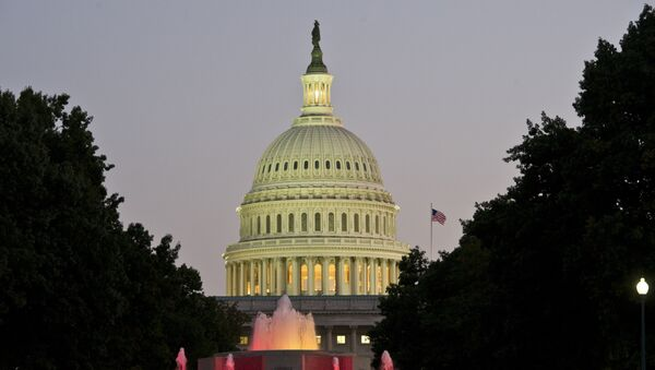The US Congress building is seen at dusk on the eve of a possible government shutdown as Congress battles out the budget in Washington, DC, September 30, 2013. - Sputnik International