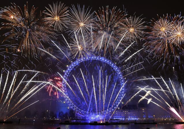 Fireworks explode over the London Eye during the New Year's eve celebrations after midnight in London, Tuesday, Jan. 1, 2019