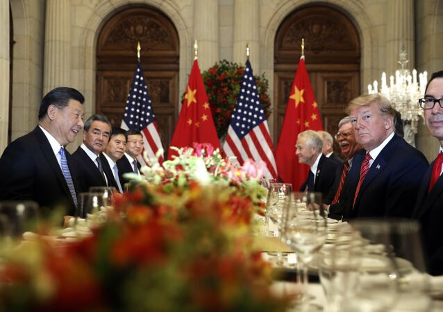 US President Donald Trump, second right, and China's President Xi Jinping, second left, attend their bilateral meeting at the G20 Summit in Buenos Aires, Argentina. File photo