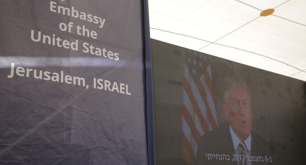 U.S. President Donald Trump is seen on screen as he delivers his speech during the opening ceremony of the new U.S. embassy in Jerusalem, Monday, May 14, 2018