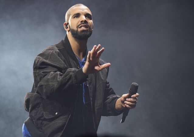 In this Oct. 8, 2016 file photo, Drake performs onstage in Toronto. Drake along with Rihanna and Kanye West scored eight Grammy nominations each, announced Tuesday, Dec. 6.