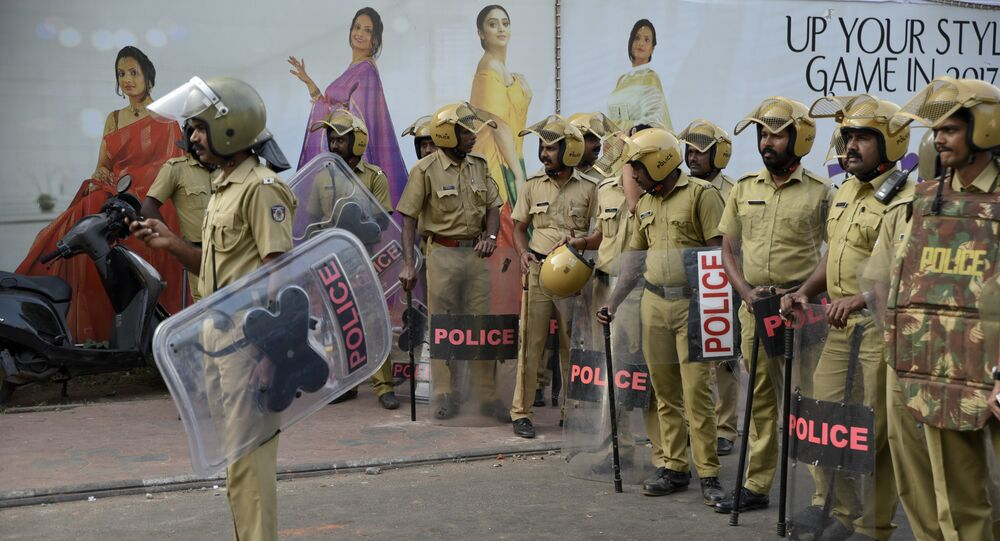 Policemen stand guard near the state secretariat anticipating protests following reports of two women of menstruating age entering the Sabarimala temple, one of the world's largest Hindu pilgrimage sites, in Thiruvananthapuram, Kerala, India, 2 January 2019