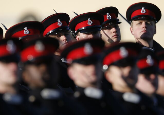 British Army officer cadets take part Britain's in the Sovereign's Parade at The Royal Military Academy Sandhurst watched by Prince Harry, in Sandhurst, England , Friday, Dec. 15, 2017.