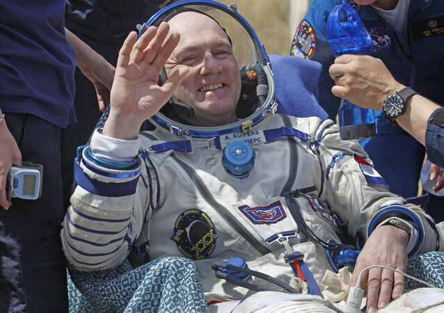 Netherlands' astronaut Andre Kuipers waves shortly after the landing of the Russian Soyuz TMA-03M space capsule at the south-east of the Kazakh town of Dzhezkazgan, Kazakhstan, Sunday, July 1, 2012