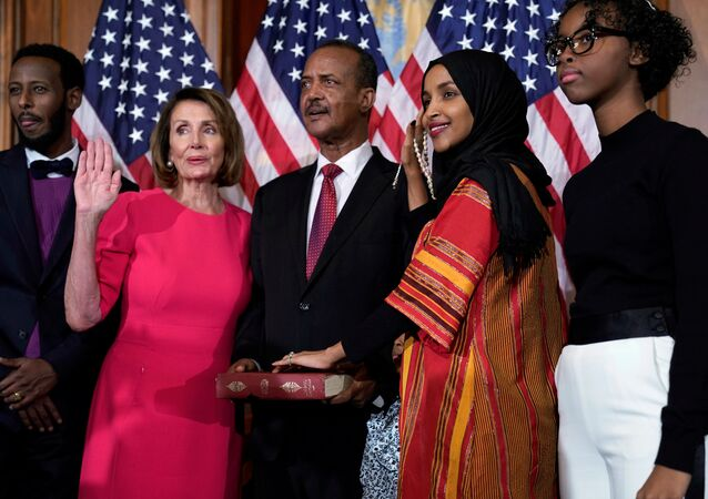 Rep. Ilhan Omar (D-MN) poses with Speaker of the House Nancy Pelosi (D-CA) for a ceremonial ceremonial swearing in picture on Capitol Hill in Washington, U.S., January 3, 2019. REUTERS/Joshua Roberts