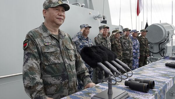 In this April 12, 2018 file photo released by Xinhua News Agency, Chinese President Xi Jinping speaks after reviewing the Chinese People's Liberation Army (PLA) Navy fleet in the South China Sea.  - Sputnik International