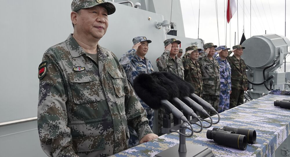 In this April 12, 2018 file photo released by Xinhua News Agency, Chinese President Xi Jinping speaks after reviewing the Chinese People's Liberation Army (PLA) Navy fleet in the South China Sea.