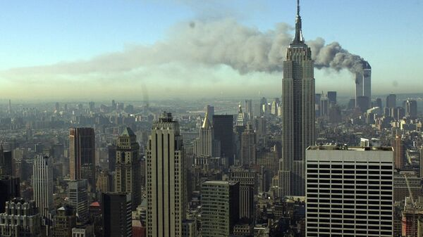 Plumes of smoke pour from the World Trade Center buildings in New York Tuesday, Sept. 11, 2001. Planes crashed into the upper floors of both World Trade Center towers minutes apart Tuesday in a horrific scene of explosions and fires that left gaping holes in the 110-story buildings - Sputnik International