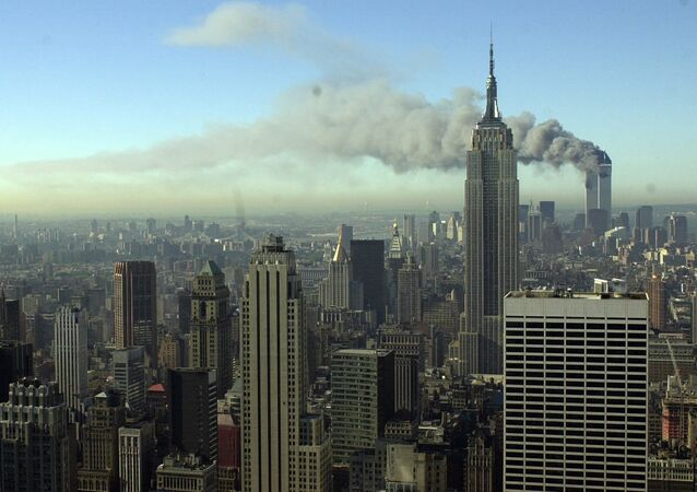 Plumes of smoke pour from the World Trade Center buildings in New York Tuesday, Sept. 11, 2001. Planes crashed into the upper floors of both World Trade Center towers minutes apart Tuesday in a horrific scene of explosions and fires that left gaping holes in the 110-story buildings