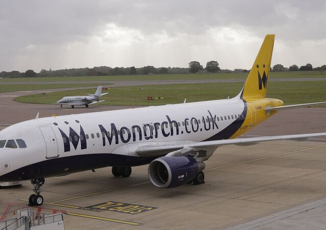 A Monarch Airlines plane, on the tarmac at Luton Airport in Luton, England