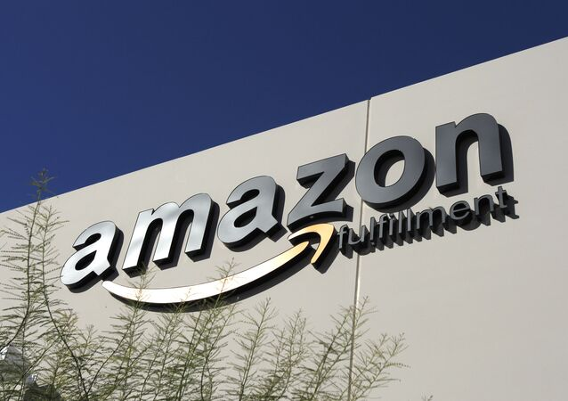 In this Nov. 11, 2010 file photo, the Amazon.com logo adorns an Amazon.com fulfillment center in Goodyear, Ariz., one of several centers in the Phoenix metro area to open in recent years. The issue of whether Amazon.com should be required to collect tax on online sales to Arizonans isn't going away. State legislators considered but ultimately shelved proposals to force the online retailer to collect tax on its sales in Arizona. But the issue is expected to resurface publicly within the next few months when a newly appointed state task force considers making recommendations for legislative action in 2013.