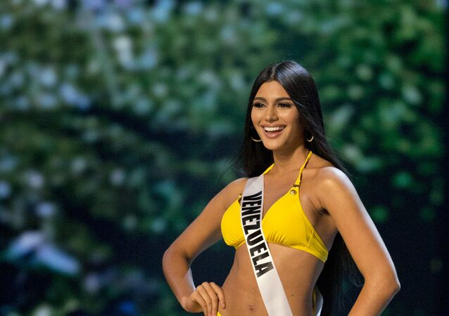 Miss Venezuela Sthefany Gutierrez participates in the swimsuit and evening gown stage of the 67th Miss Universe competition in Bangkok, Thailand, Thursday, Dec. 13, 2018