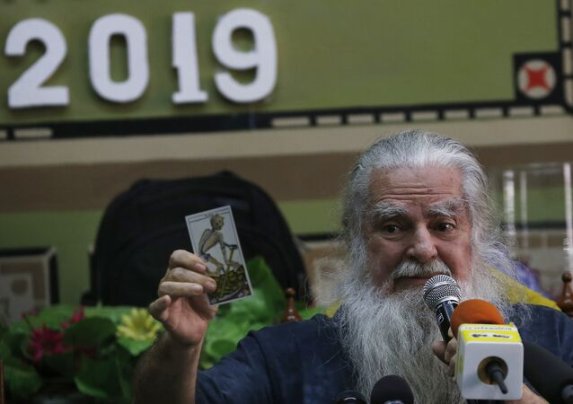 Mexico's 'Grand Warlock' Antonio Vazquez Alba gives his traditional predictions for the new year in Mexico City, Friday, Jan. 4, 2019