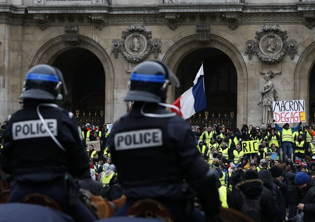 French mounted police stand in front protesters wearing yellow vests. File photo