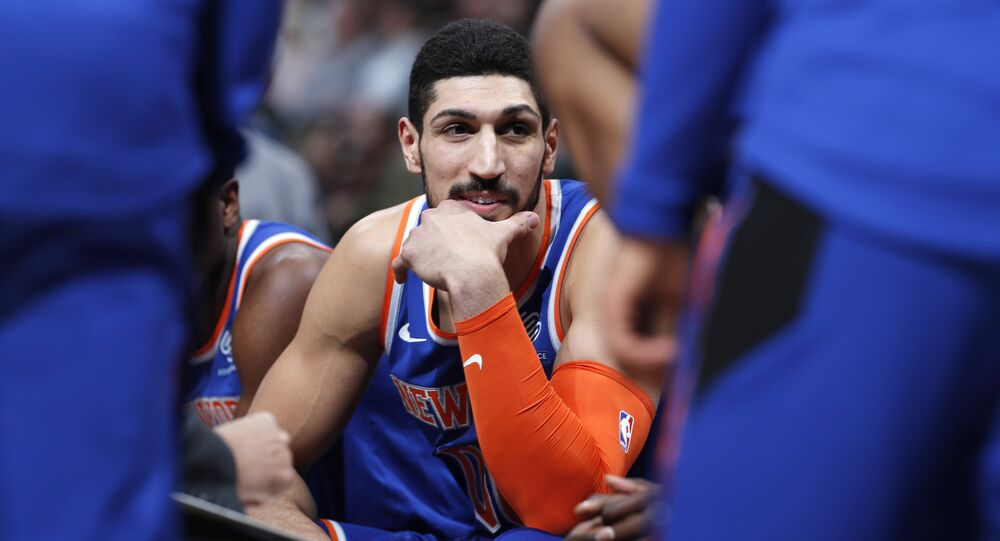 New York Knicks center Enes Kanter jokes with teammates during a timeout the first half of the team's NBA basketball game against the Denver Nuggets on Tuesday, Jan. 1, 2019
