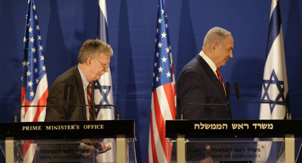 Israeli Prime Minister Benjamin Netanyahu, right, and US National Security Advisor John Bolton, leave the stage after their statement to the media follow their meeting, in Jerusalem, Sunday, Jan. 6, 2019.