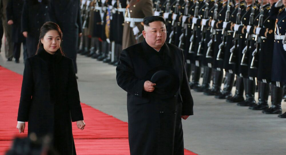 North Korean leader Kim Jong Un and wife Ri Sol Ju inspect an honour guard before leaving Pyongyang for a visit to China, this January 7, 2019 photo released by North Korea's Korean Central News Agency (KCNA) in Pyongyang January 8, 2019.