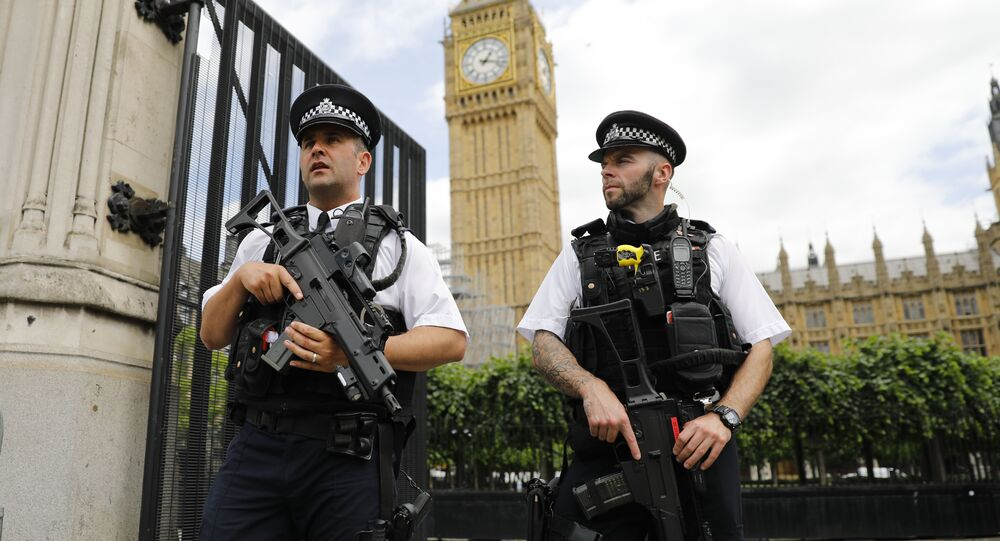 Armed police patrol by the Houses of Parliament on June 16, 2017.