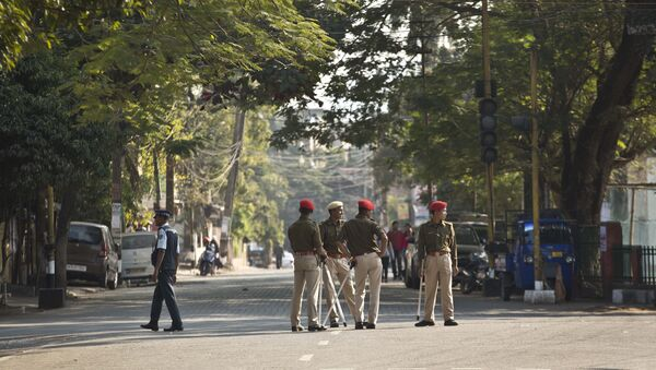 Indian police officials stand leisurely on a deserted road during an eleven hour general strike called by All Assam Students' Union (AASU) and North East Students' Organization (NESO) in Gauhati, India, Tuesday, Jan. 8, 2019. - Sputnik International