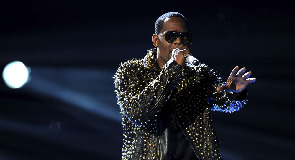 FILE - In this June 30, 2013, file photo, R. Kelly performs onstage at the BET Awards at the Nokia Theatre in Los Angeles. R. Kelly says the media are attempting to distort and destroy his legacy by reporting allegations that he sexually mistreats women. The R&B artist says in a statement Friday, May 4, 2018 that he's heartbroken by the accusations.