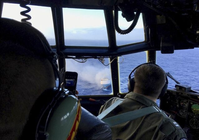 FILE - In this Dec. 31, 2018 file photo provided by the U.S. Coast Guard, a Coast Guard HC-130 Hercules aircrew flies over the 650-foot Sincerity Ace on fire 1,800 nautical miles northwest of Oahu in the Pacific Ocean